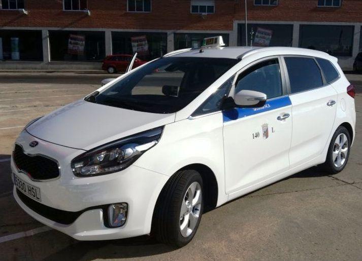 Taxi Kia Carens